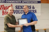 Alex Cook accepts the Community Achievement Award for Innerkip Parks & Rec from EZT Councillor Jeremy Smith.