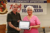 Mary-Margaret Braund accepts the Community Achievement Award for Innerkip Drop-In Centre from EZT Councillor Jeremy Smith.