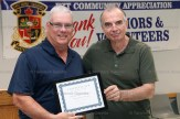 Brad Hallock accepts the Community Achievement Award for the Innerkip Umpires' Assoc. from EZT Councillor Jeremy Smith.