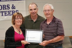 Pat and Carl Littlejohns receive the Community Achievement Award from EZT Councillor Jeremy Smith.