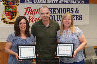 Kim Swanson (left) and Donna Lamb receive their Community Achievement Awards from EZT Councillor Jeremy Smith.