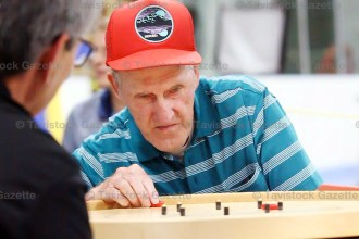 World Crokinole Championship competitive singles winner Robert Bonnett of Wingham gets ready to sink his winning 20 on Saturday evening. He edged two-time champion Jon Conrad in a double tie-breaker to take home $1,000 cash and the trophy.