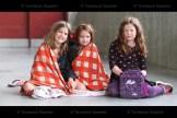 Grade 3 students Jenna McWhirter, Zoey Shantz and Alexis Mueller keep warm at the Tavistock Public School primary picnic on Wednesday, June 23rd.