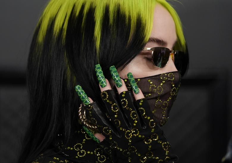 Billy Eilish with green hair and green nails.