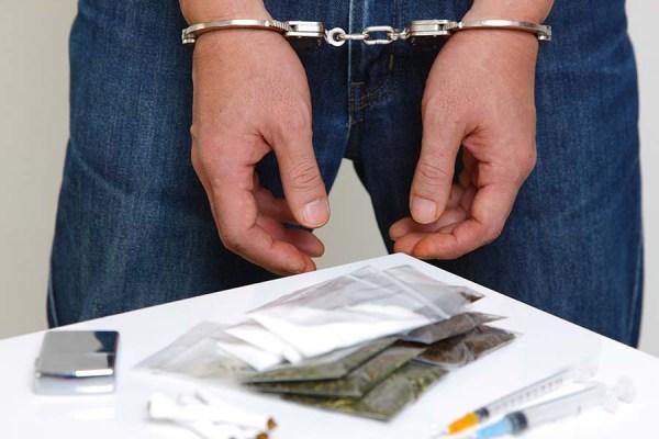 Arrested drug dealer (stock photo)