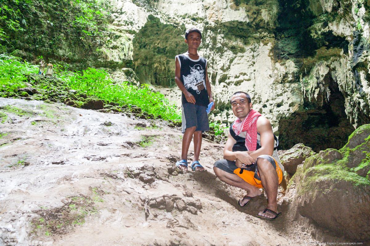 Boy guide inside Calao Cave.