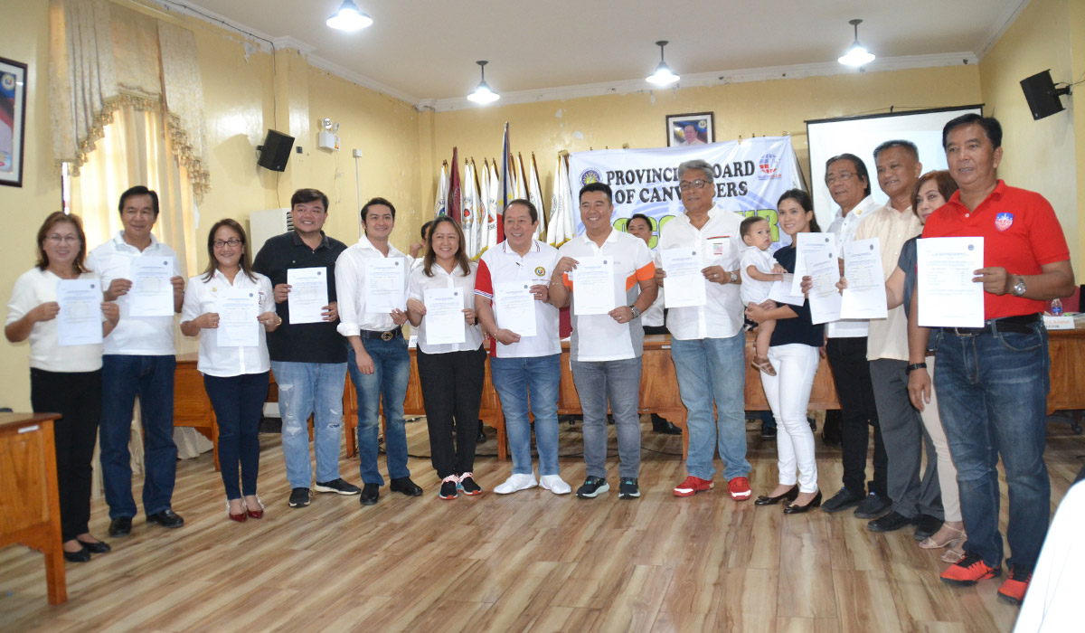 The newly elected congressional and provincial officials of Ilocos Sur hold their Certificates of Canvass after the Provincial Board of Canvassers proclaimed them as winners on May 15 at the Capitol, Vigan City.
