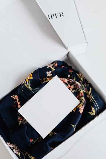 luxury silk dress with empty postcard in package