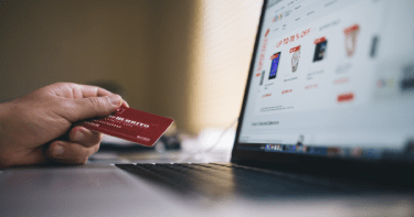 Woman making online purchase with credit card