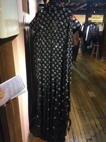Hard to show shape of dress, arms sink into the side from weight of beading