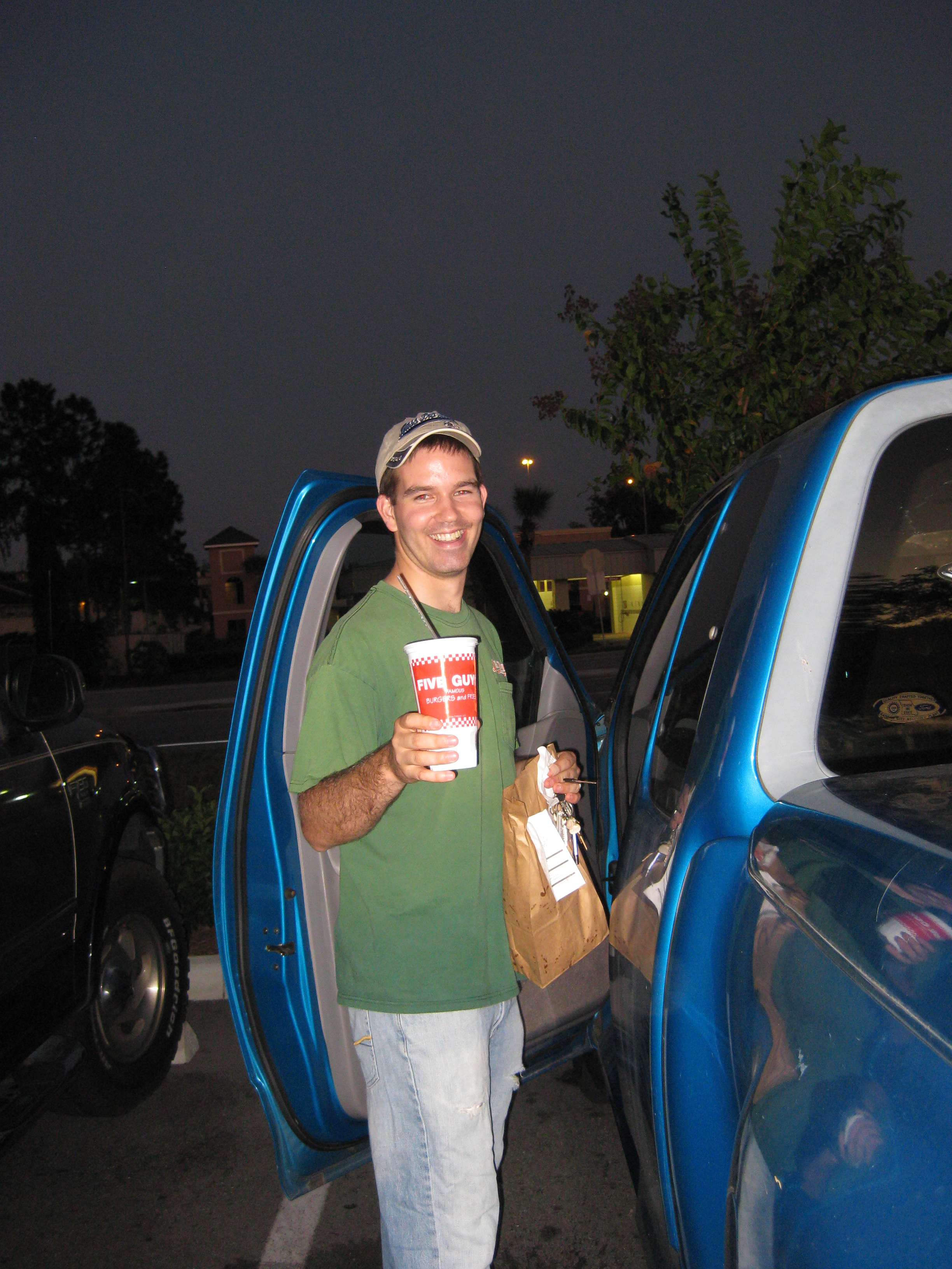 "Supporter and Friend Dan Quackenbush smiles as we prepare to eat at ""Five Guys and Fries"""
