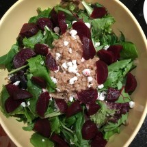 Salad greens mixed with beet greens, topped with dressed farro, beets and goat cheese