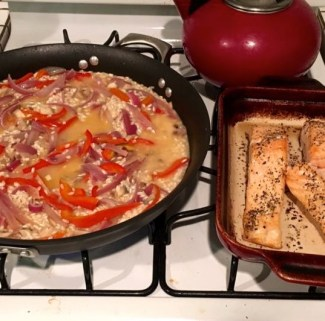 The salmon filets are 95% cooked through, and ready to be added to the risotto
