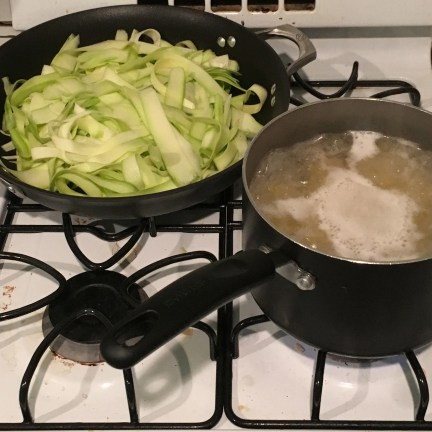 Zucchini noodles and pappardelle noodles cooking at the same time