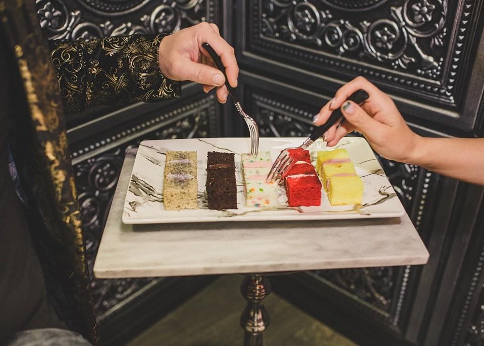 Annalee Belle & JD Scott tasting a few of Showboy Bakeshops' wedding cake flavors.