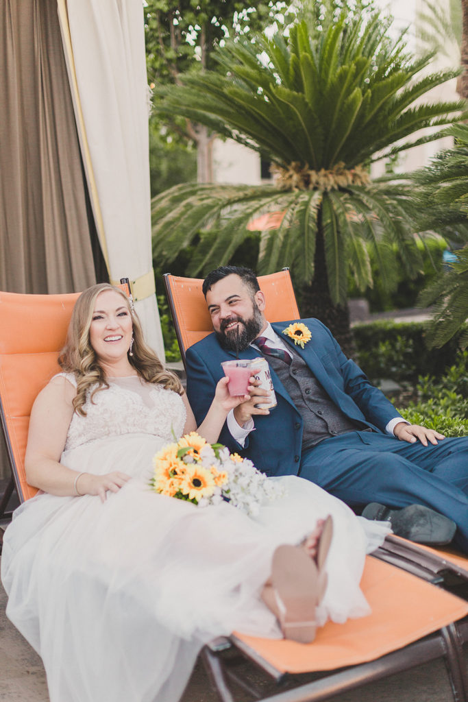 soon-to-be-married couple enjoys frozen drink at MGM Grand pool on wedding day with Taylor Made Photography