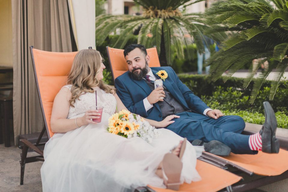 couple enjoys drinks poolside at MGM Grand with Taylor Made Photography
