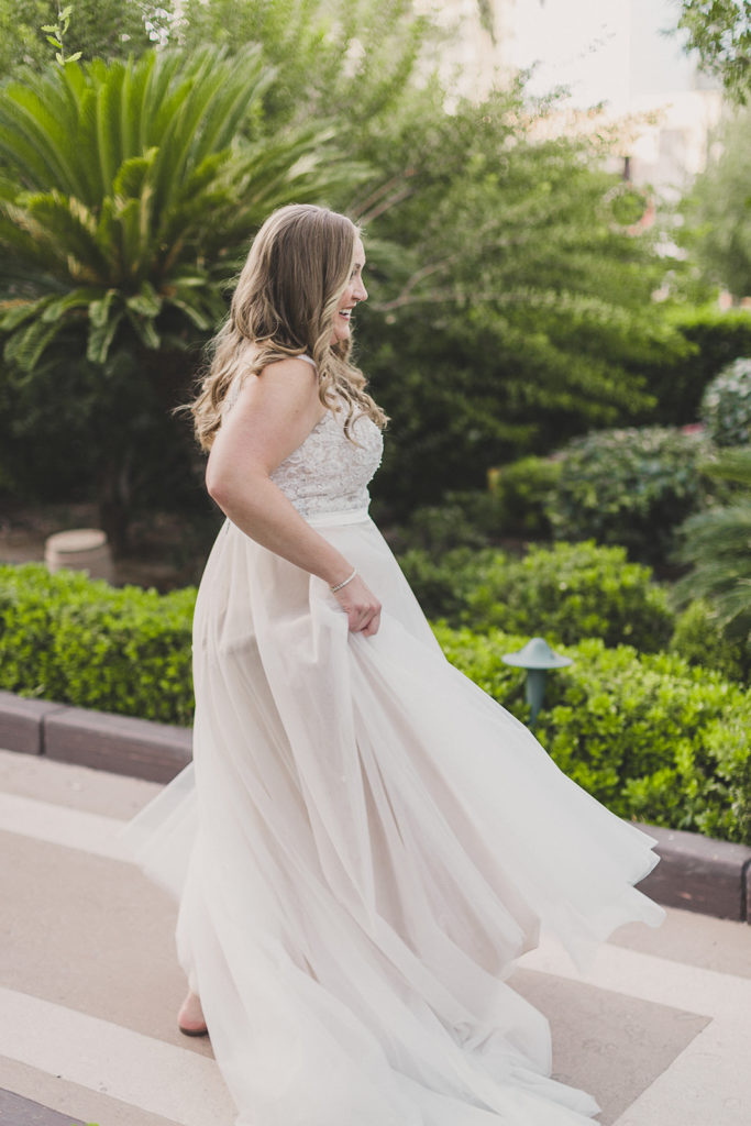 bride twirls in wedding gown photographed by Taylor Made Photography