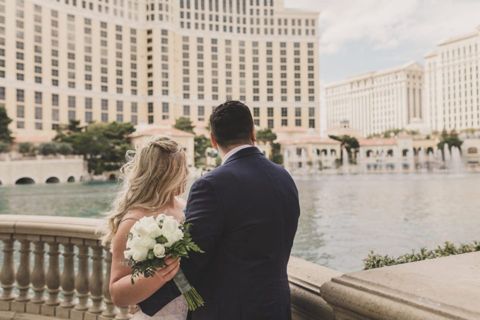 bride and groom look out on Lake Las Vegas with Taylor Made Photography