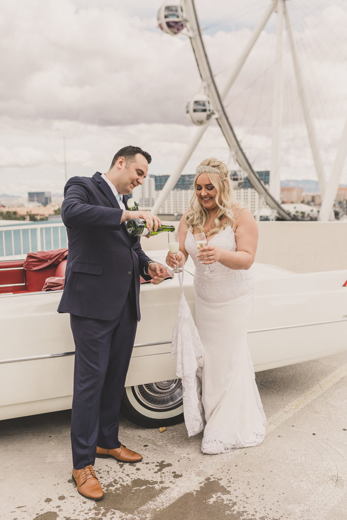bride and groom enjoy champagne on their wedding day