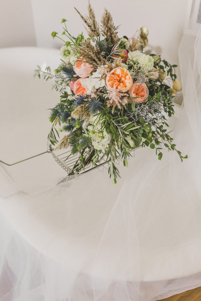 bridal bouquet with coral flowers and dried grass in Las Vegas