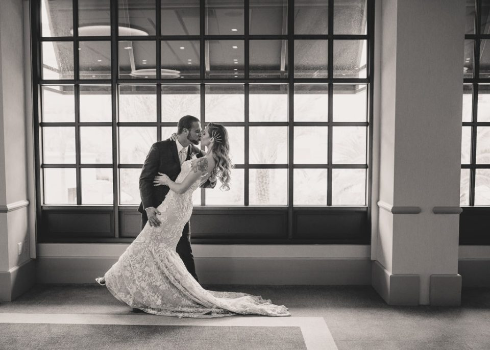 bride and groom kiss on wedding day with Taylor Made Photography