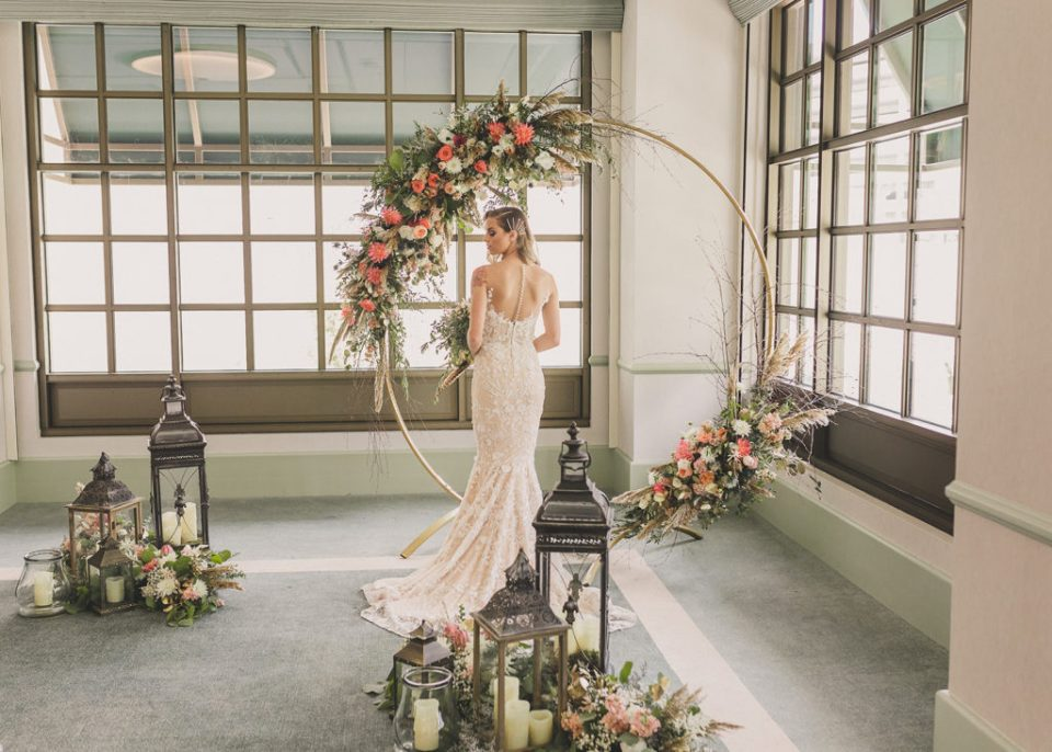 bridal portrait by golden circle arbor in Griffith Ballroom at Park MGM
