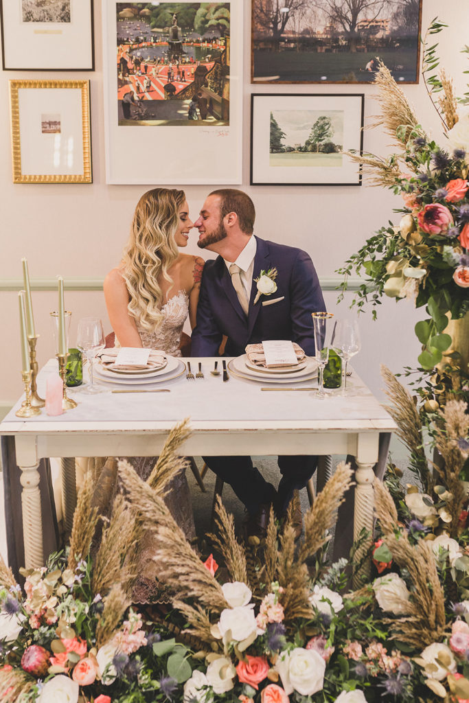Las Vegas sweetheart table with florals with dried grass and roses