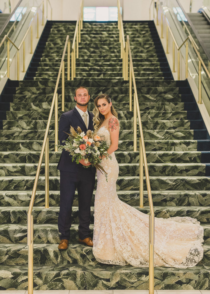 bride and groom pose on Park MGM staircase photographed by Taylor Made Photography