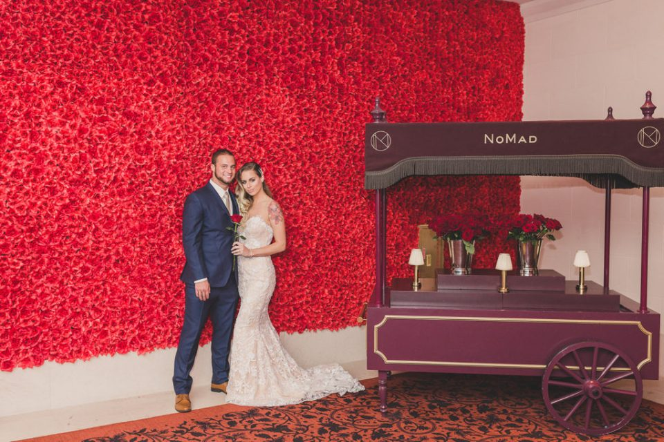 Nomad wedding portraits with rose wall photographed by Taylor Made Photography