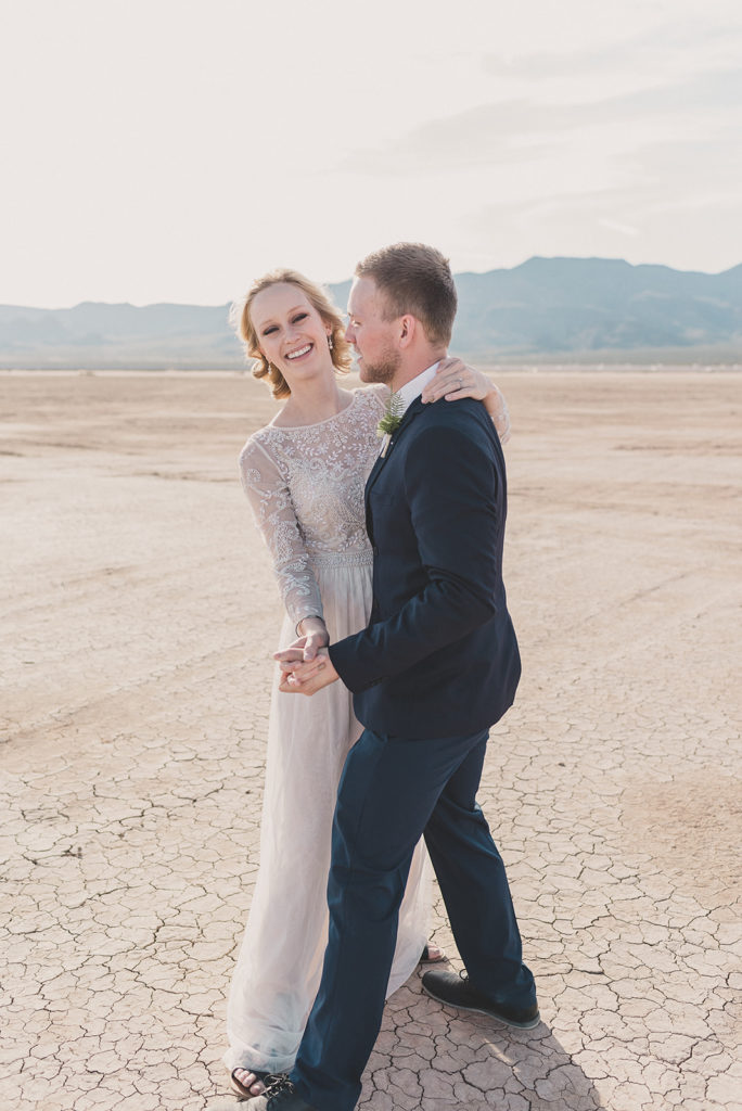 bride and groom dance at El Dorado Dry Lake Bed with Taylor Made Photography