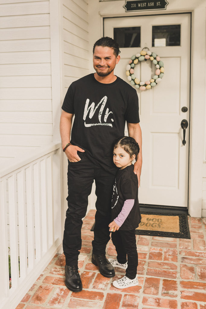 father and daughter pose on front steps before wedding day for Taylor Made Photography