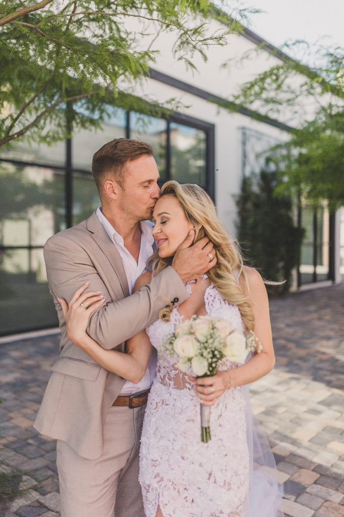 bride and groom embrace with Las Vegas photographer Taylor Made Photography