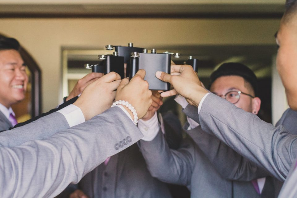 groom and groomsmen cheer during wedding prep for Canyon Gate Country Club wedding with Taylor Made Photography