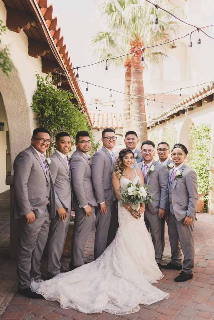 groomsmen in grey suits pose for Taylor Made Photography