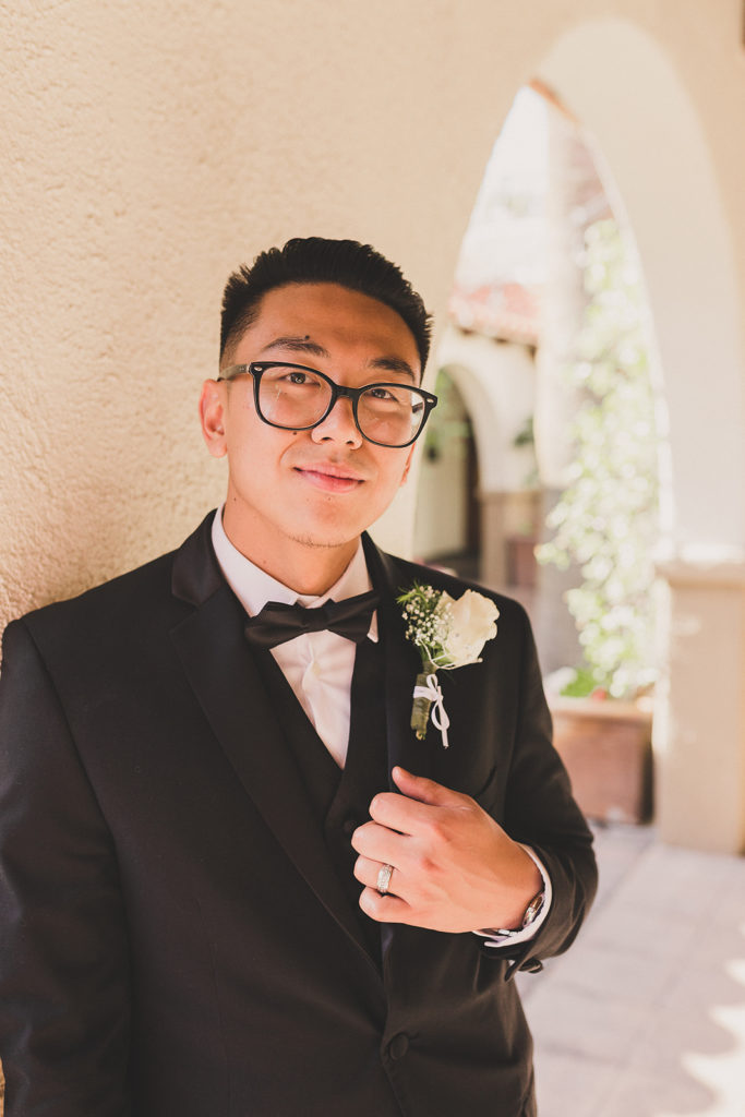 groom poses for Las Vegas wedding photographer Taylor Made Photography