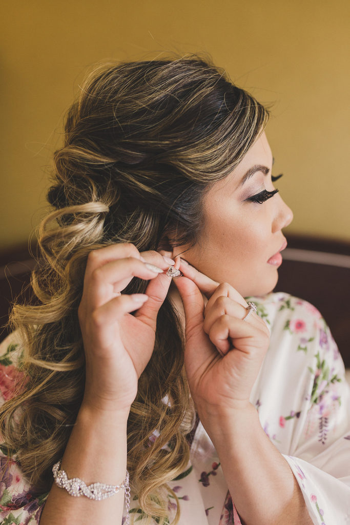 bride prepares for wedding day in Las Vegas with Taylor Made Photography