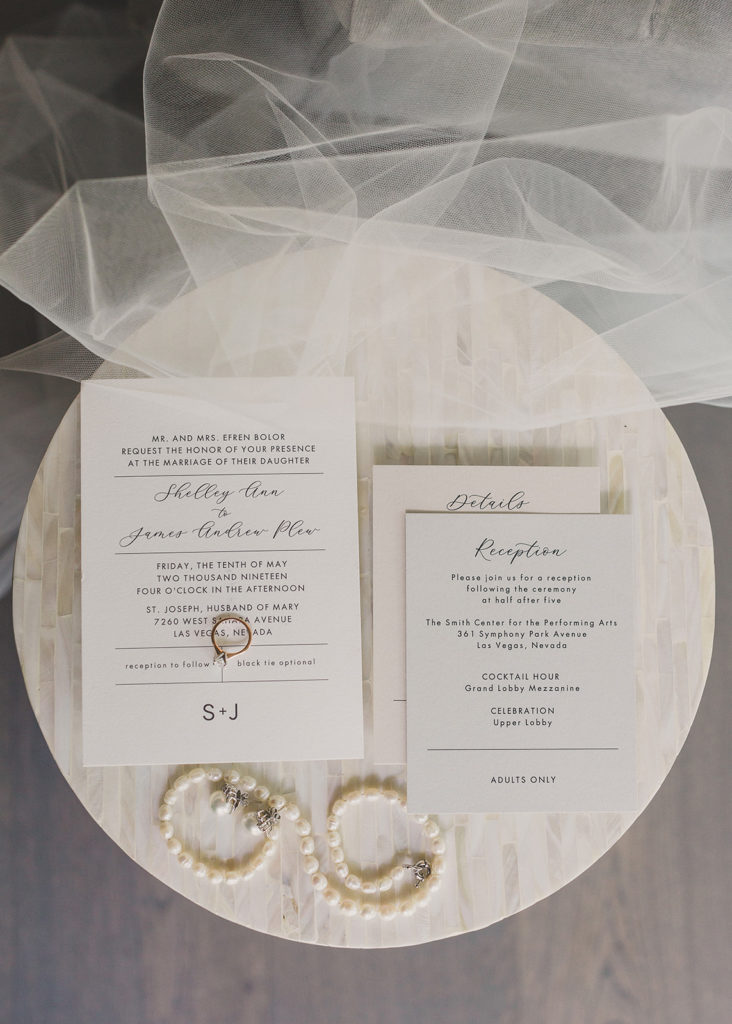 Taylor Made Photography captures invitation suite and wedding rings