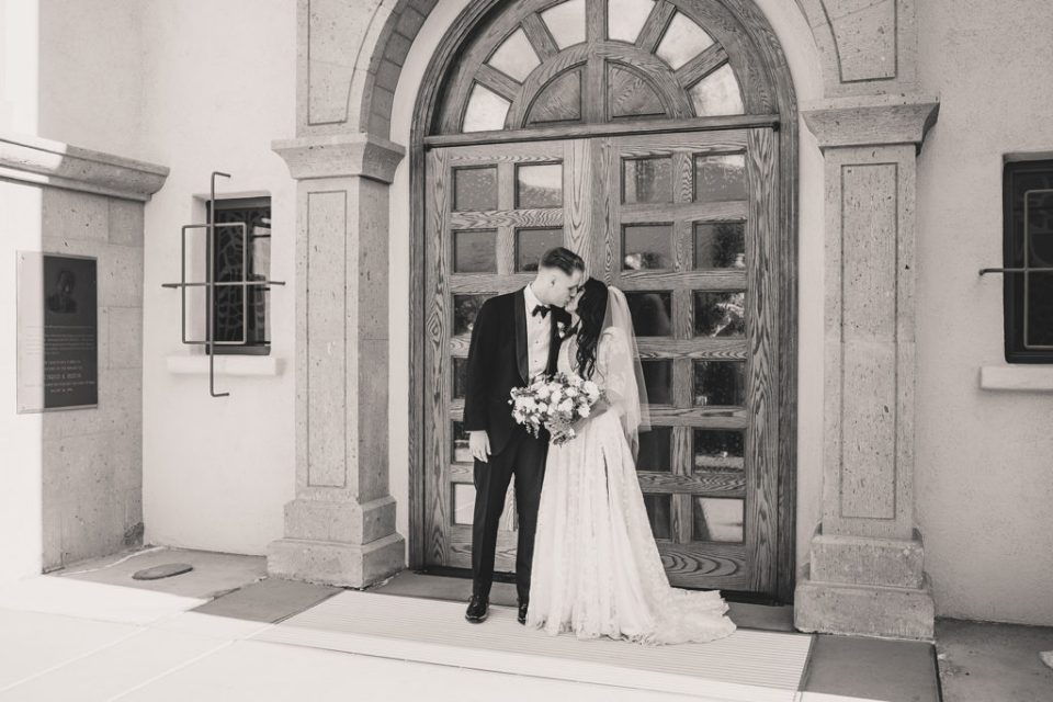 romantic bride and groom portraits outside the Smith Center for the Performing Arts by Taylor Made Photography