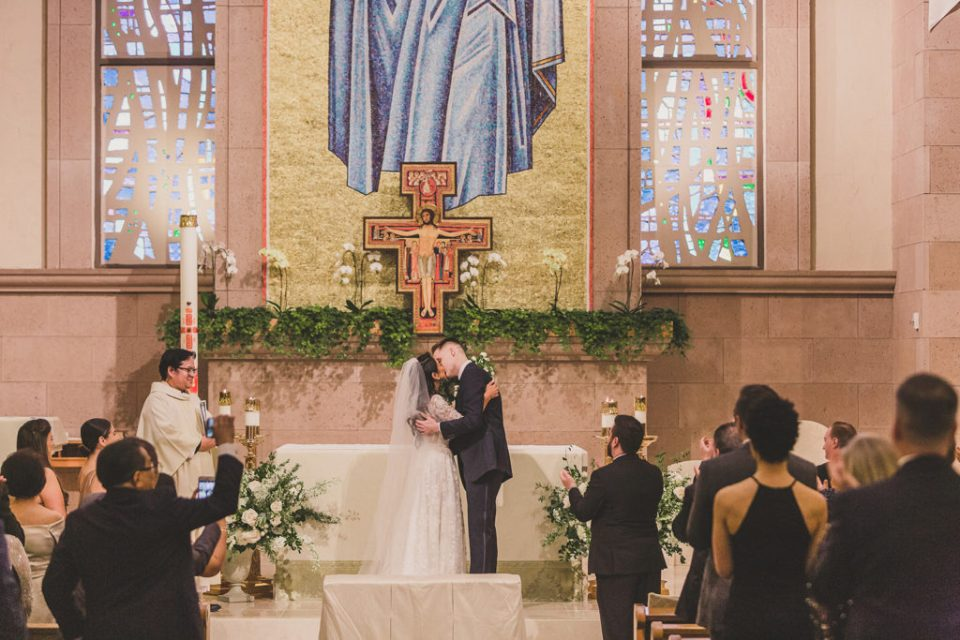 Catholic wedding first kiss photographed by Taylor Made Photography