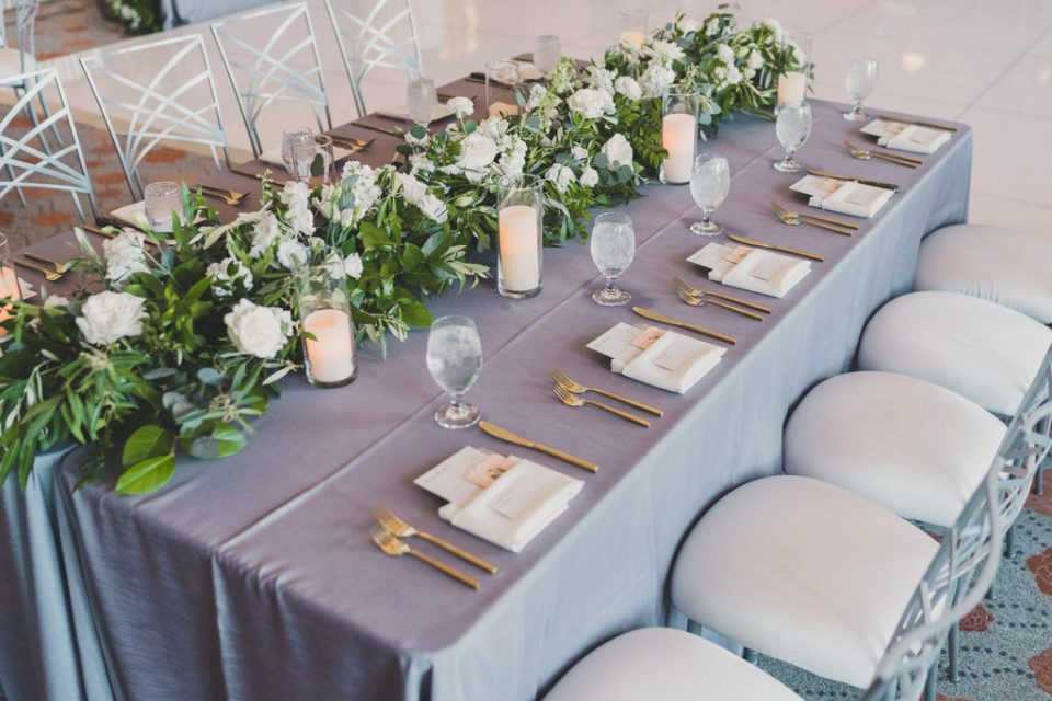 silver and ivory wedding reception details photographed by Taylor Made Photography