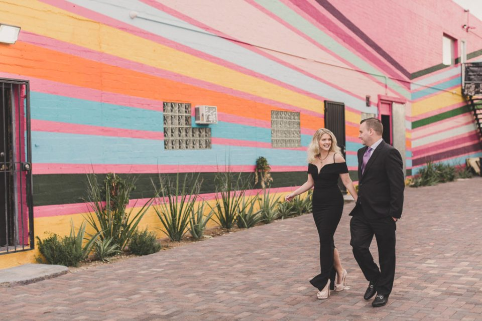 anniversary portraits near neon murals in Las Vegas with Taylor Made Photography