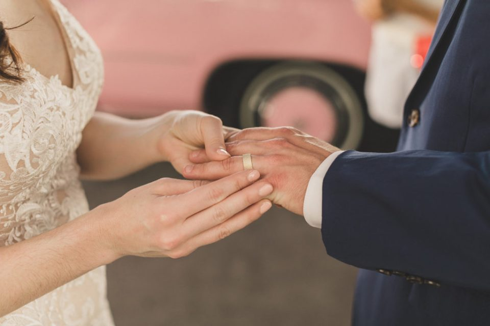 bride places ring on groom's hand during elopement with Taylor Made Photography