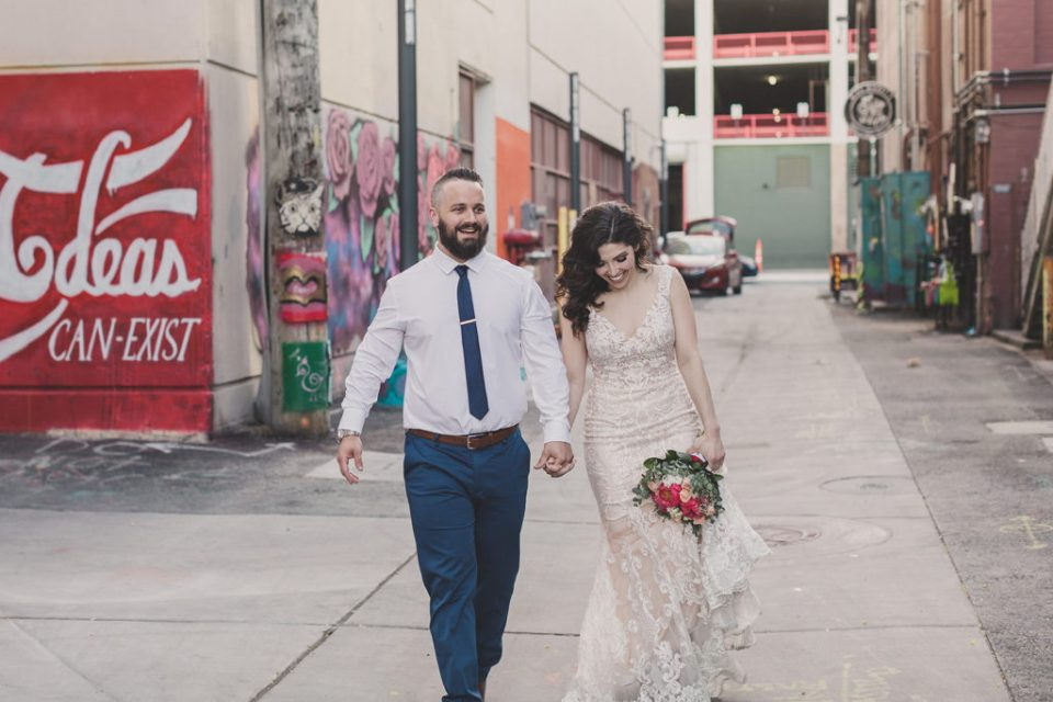 bride and groom walk in downtown Las Vegas photographed by Taylor Made Photography