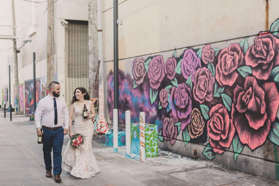 bride and groom cheer on the streets of Las Vegas photographed by Taylor Made Photography