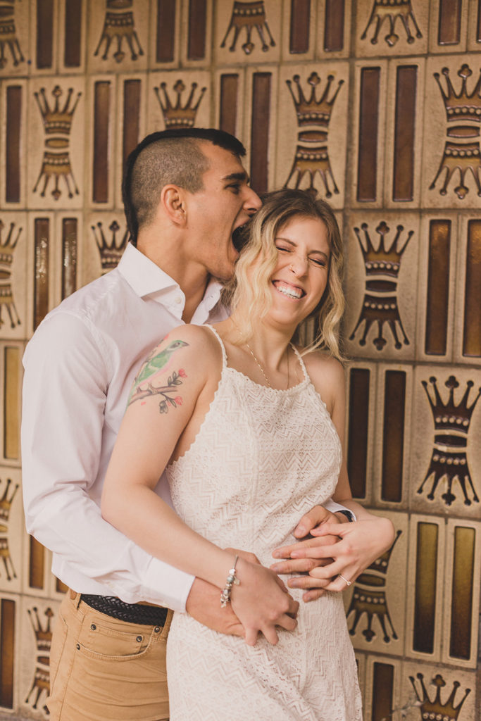 groom makes bride laugh during engagement session in Las Vegas with Taylor Made Photography