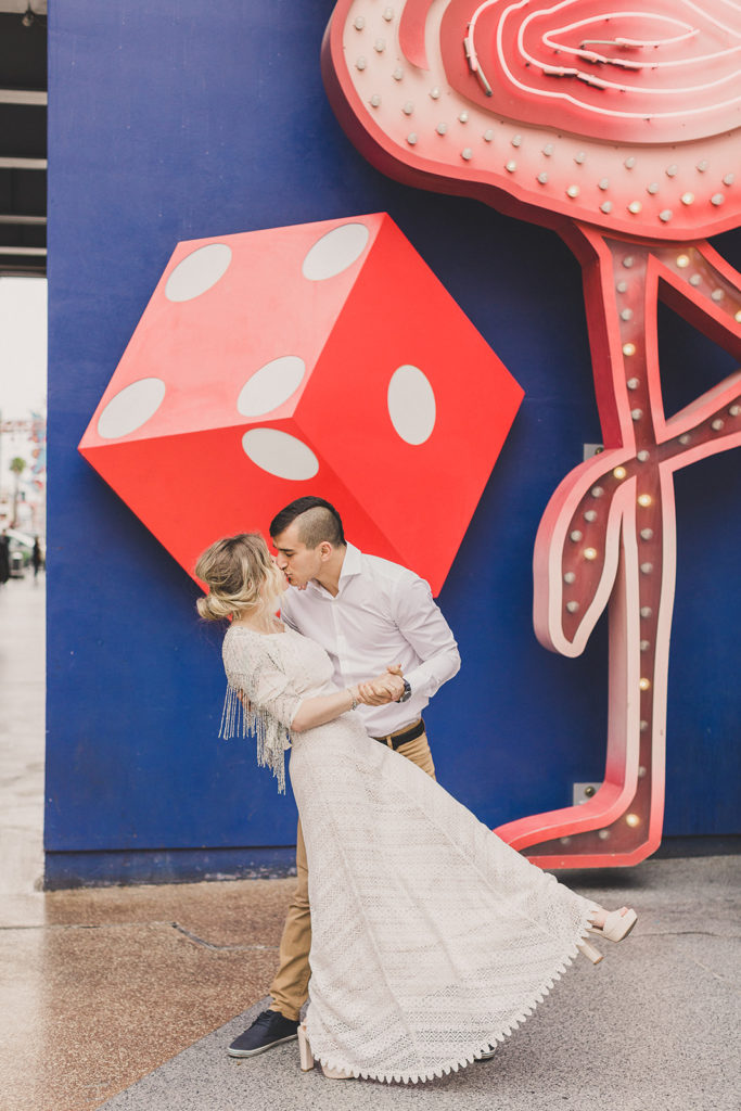 Taylor Made Photography capture couple dancing by dice and flamingo on Fremont Street