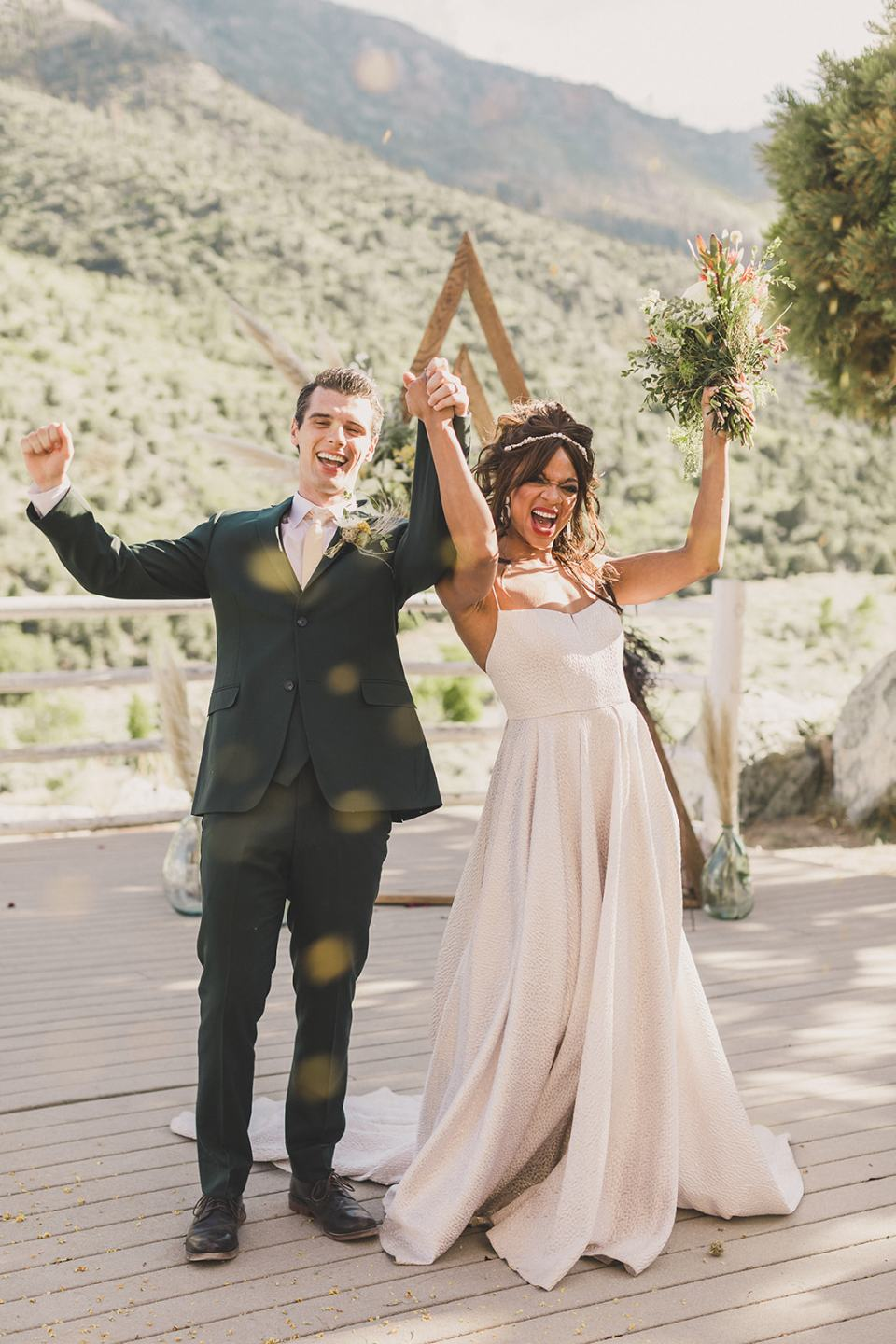 bride and groom cheer after getting married photographed by Taylor Made Photography