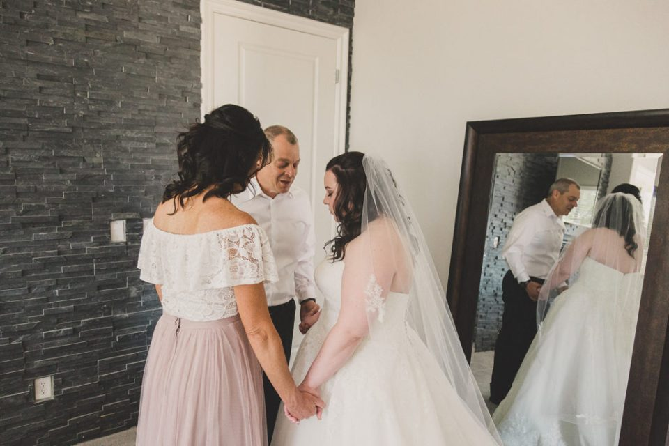 bride prays with mother and father photographed by Taylor Made Photography