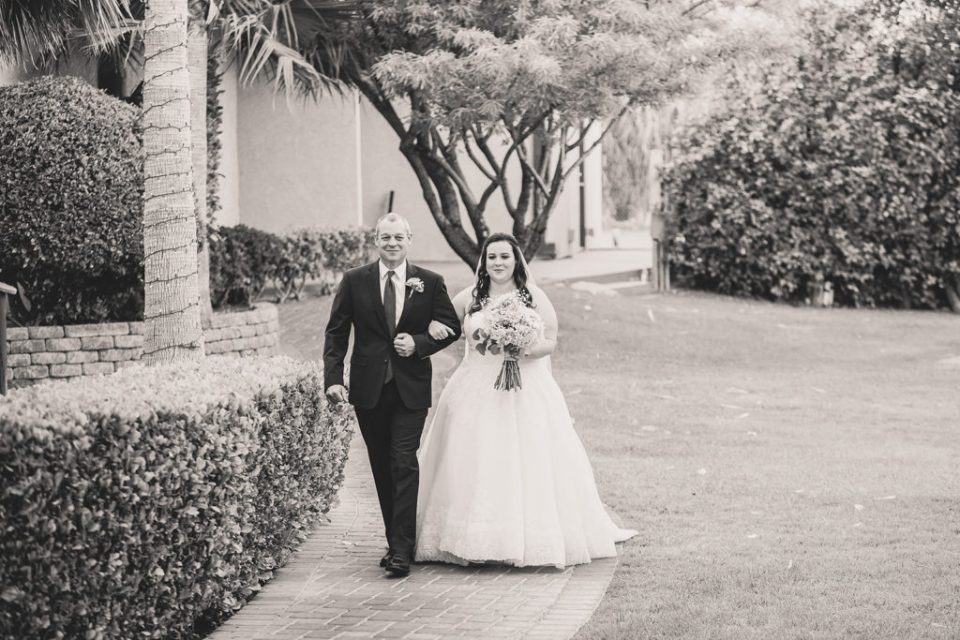 bride and father walk into wedding ceremony photographed by Taylor Made Photography